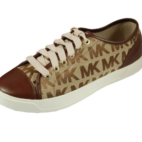 256b5056f9e9 Michael Kors Women s MK City Sneakers. M 5bf596fdaa8770a189b792e8